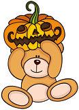 Teddy bear holding halloween pumpkin