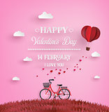 Red bikes parked on the grass with heart shaped balloons  floati
