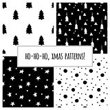 Set of black and white seamless patterns with Christmas trees and stars for Christmas and New Year's wrapping paper. Vector illustration.