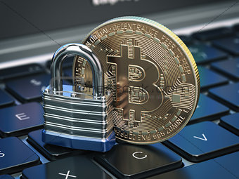 Cryptocurrency bitcoin coin and padlock lock on computer keyboar