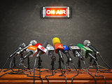 Press conference or interview on air.  Microphones of different
