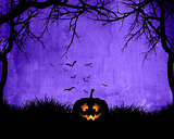 Halloween background with pumpkin on purple background