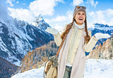 traveller woman in winter outdoors catching snowflakes