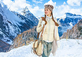traveller woman against winter mountain landscape looking aside
