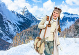 happy woman against mountain scenery in South Tyrol, Italy