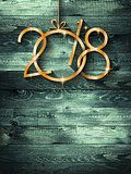 2018 Happy New Year seasonal background with real wood green pine