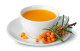 Juice from sea-buckthorn in a cup with berries