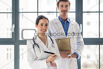 Portrait of two determined physicians looking at camera in a mod