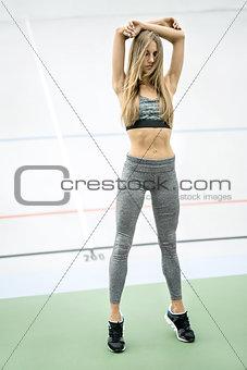 Sportive girl posing outdoors