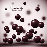 Dark chocolate balls on abstract background.
