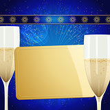 Christmas gift golden card and champagne glasses on blue