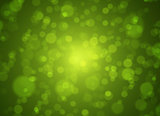 Soft green and gold bokeh background. Abstract spring concept.