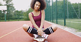 Charming model sitting on skateboard
