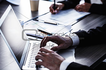 Man working on a laptop. Concept of internet sharing and interconnection