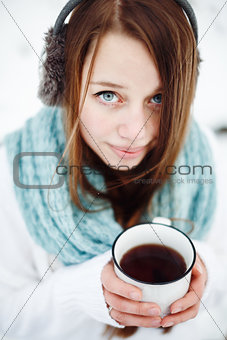 Young attractive woman drinking tea outdoors