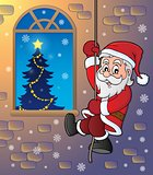 Climbing Santa Claus theme image 2