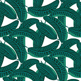 Emerald green palm leaves dense bold seamless vector pattern.