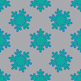 Seamless pattern with snowflakes on gray