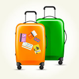 Modern plastic wheeled suitcases with travel tags