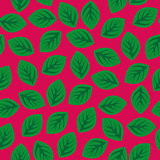 Seamless pattern with green leaves on pink