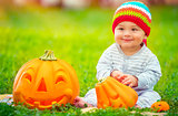 Cute baby with Halloween pumpkins