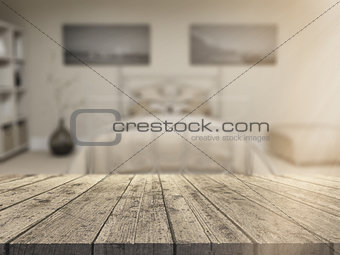 3D wooden table looking out to a defocussed bedroom interior