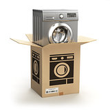 Washing machine in carton cardboard box. E-commerce, internet on