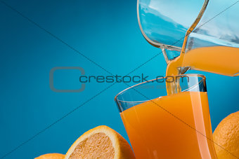 Pouring orange juice into a glass