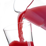 Pouring delicious pomegranate juice