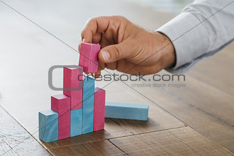 Businessman building a successful financial graph