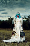scary evil clown in a bride dress outdoors