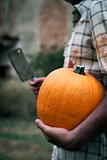 scary man with a pumpkin and a cleaver
