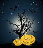 Orange pumpkins and silhouette of tree