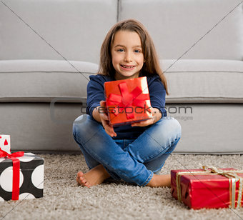 Little girl opening presents