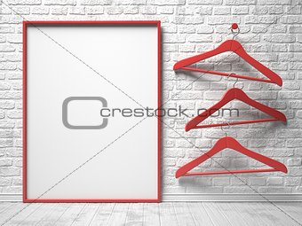 Three red cloth hanger and blank canvas