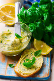 Butter with a basil and a lemon for sandwiches