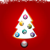 Christmas tree with bingo lottery balls on red background