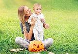 Mother and baby enjoying Halloween