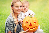 Happy family with Halloween pumpkin