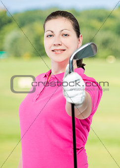 beautiful brunette golfer with a club in his hand on a backgroun