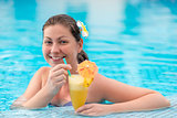 woman 30 years in the pool enjoying relaxation and cocktail