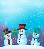 Christmas snowmen in snowy weather