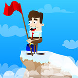 Businessman with red flag on a mountain.