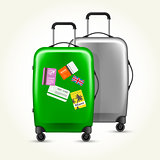 Wheeled suitcases with travel tags - silver and green baggage