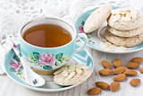Cup tea with almond cookies