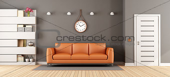 Gray living room with orange sofa