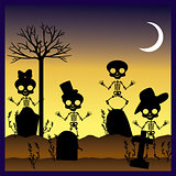 silhouettes of skulls in graveyard