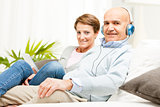 Couple relaxing together listening to music