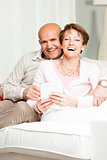 Happily married laughing middle-aged couple