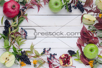 autumn background of leaves, fruits and berries